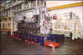 Large heavy diesel engines are floated on air during manufacturing and engine assembly