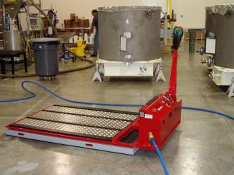 Air Bearings reduce the friction under this tote so that it can be positioned omni-directional by use of a low-profile drive unit. This unit is one of many Air Film Transporters built by Solving.